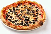A Pizza Margherita topped with black olives