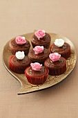 Chocolate muffins decorated with sugar flowers