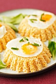Millet cakes with fried quail's eggs