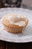 An apple muffin with cinnamon sugar