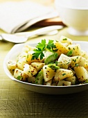 Potatoes with celery and herbs