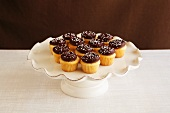 Mini Cupcakes with Chocolate Frosting on a Pedestal Dish