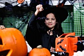 Little girl in a witch's outfit at a Halloween party