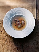 Game broth with liver dumplings