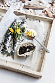 Fish, baked in sesame seeds, with mango butter