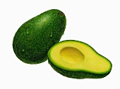 An avocado and half an avocado without a stone (illustration)