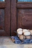 Fresh eggs in a metal basket