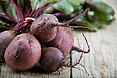 Fresh beetroot on a wooden table (close-up)