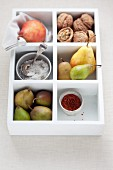 Assorted varieties of pear in a wooden box