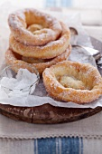 Bavarian-style doughnuts with sugar on baking paper