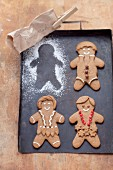 Gingerbread men on a baking tray