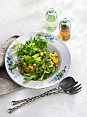 Asparagus and rocket salad with beans, figs and a mustard dressing