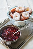 Ausgezogene (Bavarian-style doughnuts) and damson compote on a silver tray