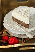 A slice of poppy seed cake with coconut mousse for Christmas