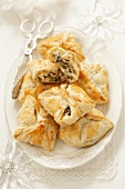 Puff pastry pockets with quark, olives and capers (Christmas)