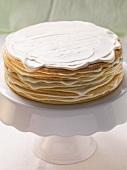 Layered honey cake being made