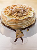 A layered honey cake on a cake stand
