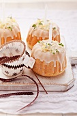 Mini Bunt cakes decorated with thyme, icing and candles