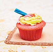 Raspberry Cupcake with Lemon Frosting and Candy