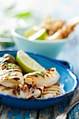 Grilled squid with lemons, olive oil and parsley