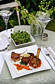 Trio of lamb with vegetables and salad