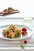 Potato salad with radishes, artichokes and parsley