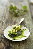 Pesto on a plate with a spoon