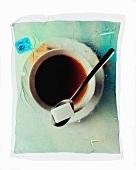 Black tea with a sugar cube
