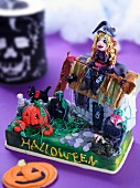 A Halloween cake decorated with a witch