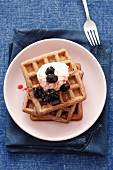 Chocolate waffles with cherries and cream
