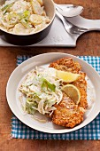 Schnitzel with almond crumb coating and potato salad