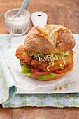 Schnitzel roll with lettuce, tomato and edible shoots