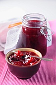 Strawberry jam in a bowl and in the jam jar