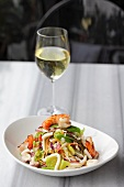 Seafood salad with a glass of white wine