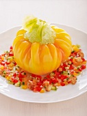 Stuffed yellow tomato with tomato granita and salsa