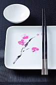 Asian tableware with a flower motif and chopsticks