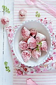 Raspberries coated in meringue