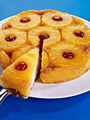 Pineapple upside-down cake, a piece on server