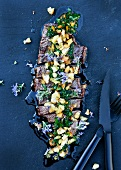 Grilled beef with a herb sauce