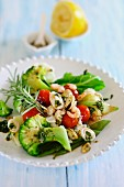 Tomato and broccoli salad with seafood