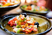 Single Servings of Moroccan Salad; Made with Tomatoes, Black Olives, Onion and Green Peppers