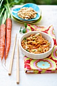 Gluten-Free Spaghetti Squash Noodles with Thai Peanut Sauce in a Bowl; Chopsticks and Carrots
