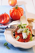 Baked tomato with cream cheese and herbs