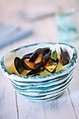 Mussels in Broth in a White Bowl; From Above