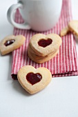 Heart-shaped biscuits with cranberry jam