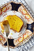 A slice of carrot and orange cake