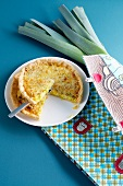 Leek tart, with a slice cut out
