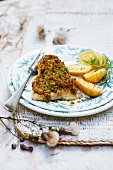 Fish fillet with herb crust and potatoes