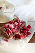 Chocolate Oatmeal Pudding Breakfast Cake with Raspberries and a Glass of Milk