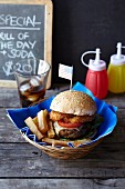 Cheeseburger with onion rings, chips and cola (USA)